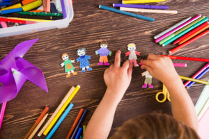 Child with people crafts at childcare